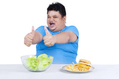 Man showing healthy and unhealthy food 3 Stock Photo