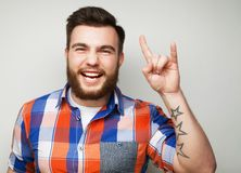 Man showing heavy gesture Stock Photos