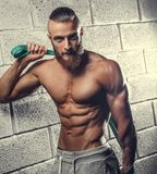 A man showing his athletic torso. Strong shirtless muscular man showing his athletic torso Royalty Free Stock Photos