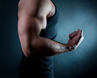 Man showing his biceps. Picture of biceps of male stock photography