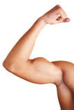 Man showing his biceps. A young man flexing his biceps muscles Stock Photos