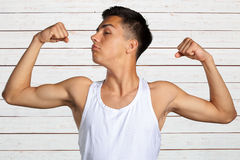 Man showing his biceps stock images