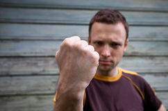 Man showing his big fist Stock Photo