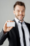 Man showing his business card. Stock Images
