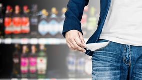 Man showing his empty pocket on blur alcohol. Man showing his empty pocket on blur alcohol background Stock Image