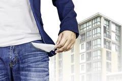 Man showing his empty pocket with condominium background. Man showing his empty pocket with new condominium background Royalty Free Stock Photography