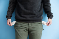 Man showing his empty pockets Royalty Free Stock Photo