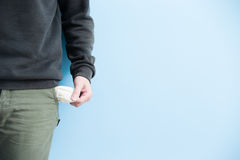 Man showing his empty pockets Stock Images