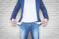 Man showing his empty pockets Royalty Free Stock Images