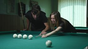 Man Showing His Girl Where To Hit The Ball - Young Woman Receiving Advice On Shooting Pool Ball While Playing Billiards.  stock video footage