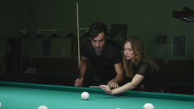 Man Showing His Girl Where To Hit The Ball - Young Woman Receiving Advice On Shooting Pool Ball While Playing Billiards.  stock video