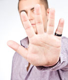Man showing his hand over gray - focus is on hand Stock Images