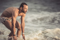 Man showing his muscles Royalty Free Stock Image