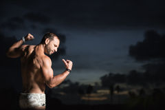 Man showing his muscles Stock Image