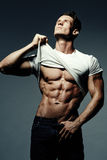 Man showing his muscular body Royalty Free Stock Photos