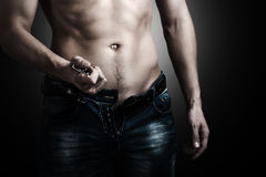 Man showing his muscular body. Stock Photos