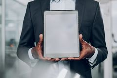 Man is showing his pc tablet and holding by both hands royalty free stock photo