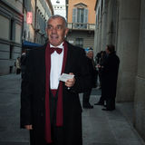 Man showing his ticket outside La Scala opera house in Milan, Italy Royalty Free Stock Image