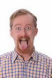 Man showing his tongue Royalty Free Stock Image