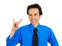 Man showing a hook 'em horns or rock on sign Stock Photos