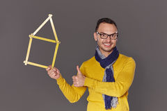 Man showing house frame concept Stock Image