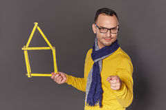 Man showing house frame concept Royalty Free Stock Image