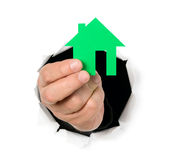Man is showing house shape through a hole. Man is showing house shape in his finger through a hole Stock Photography