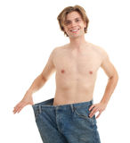 Man showing how much weight he lost Royalty Free Stock Image