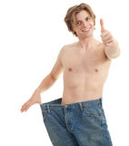 Man showing how much weight he lost Royalty Free Stock Photo