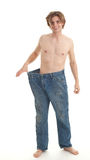 Man showing how much weight he lost Stock Image