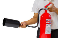 A man showing how to use fire extinguisher isolated over white. Background Royalty Free Stock Images