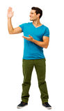 Man Showing An Imaginary Product Against White Background Stock Photography