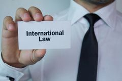 Man showing International Law text. Business concept Royalty Free Stock Photos