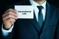 Man showing International Law text. Business concept Stock Image