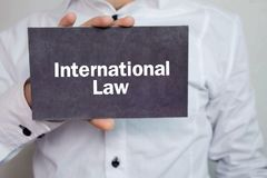 Man showing International Law text. Business concept Stock Photo