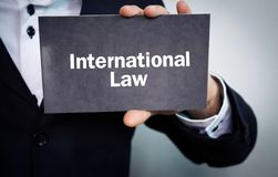 Man showing International Law text. Business concept Royalty Free Stock Image