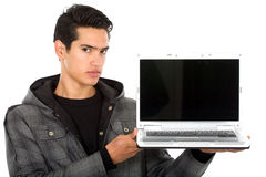 Man showing a laptop computer Stock Photo