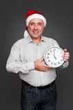 Man showing the midnight on the clock Stock Images