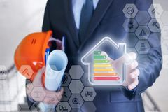 Man showing model energy-efficient house. Man showing model energy-efficient house on blurred background Royalty Free Stock Photo