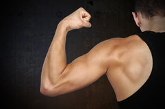 Man showing muscles Stock Photo