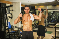 Man showing muscles in gym Royalty Free Stock Photos