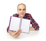 Man showing notepad Royalty Free Stock Image