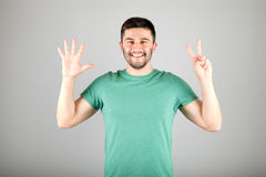 Man showing number by fingers Royalty Free Stock Photo