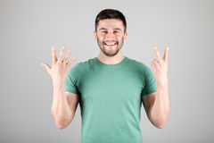 Man showing number by fingers Royalty Free Stock Photography