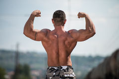 Man Showing Off His Muscle Royalty Free Stock Photography