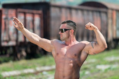 Man Showing Off His Muscle Stock Image