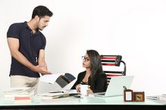 Man is showing office file to woman royalty free stock photography