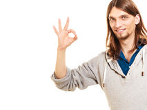 Man showing ok fine alright gesture. Isolated on white background royalty free stock photos