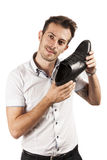 Man showing one shoe Stock Photos
