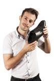 Man showing one shoe. Isolated on white background Stock Photos